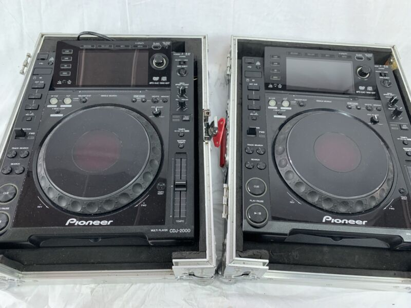 Two (2) Pioneer CDJ-2000 With Hard Shell Road Cases. Good Condition.