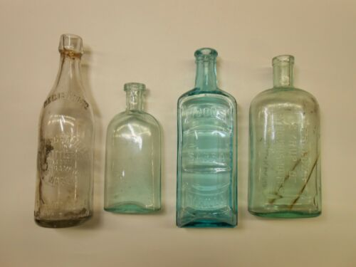 4 Different antique bottles