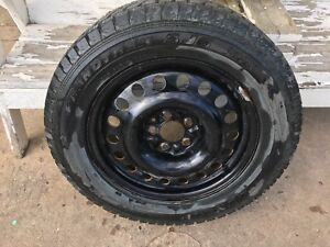 Four 235 60 R17 winter tires and rims for sale.