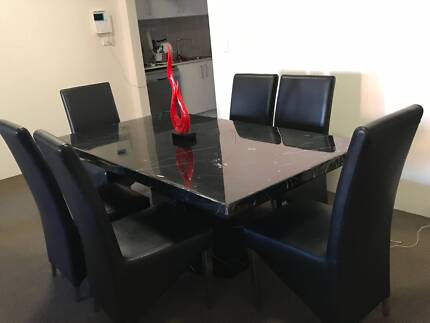 Black marble dining table with six chairs