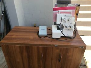 Janome My Lock 234D with work/storage unit