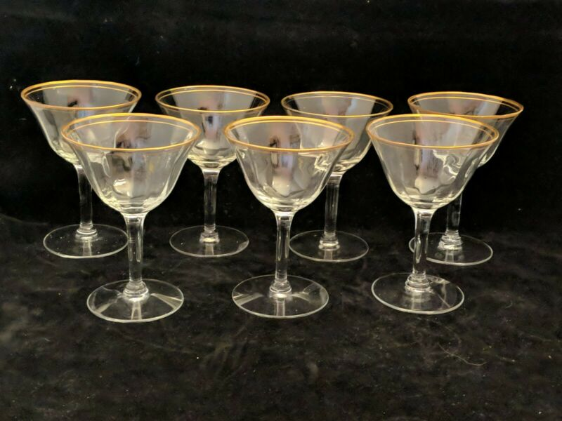 Set of 7 champagne coupes 2 gold bands on rim optic smooth stem   820cgr