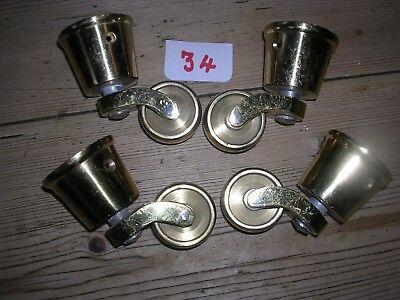 SET OF 4 BRASS CASTORS (TAG 34)