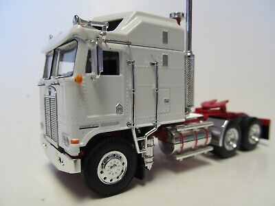DCP 1/64 SCALE KENWORTH K-100 STUDIO, WHITE WITH RED FRAME, DUAL CHROME STACKS