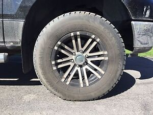 Set of four tires and rims