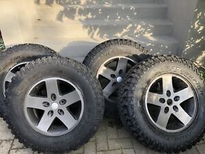 Five BFG Mud Terrain tires and JK Moab Wheels 255/75/17