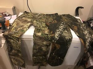 Ladies camo pants and sweater.