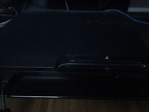 Playstation 3 (120gb) with 2 controlers and 9 games
