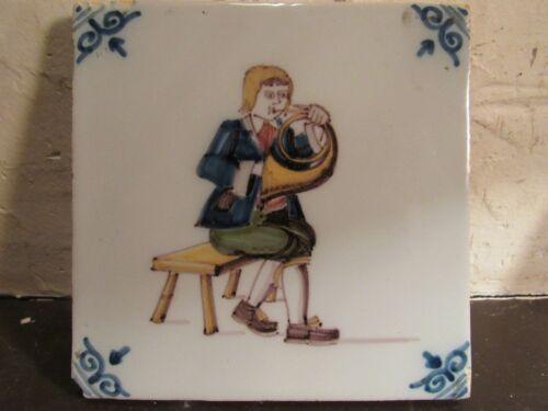 ANTIQUE CERAMIC TILE BOY PLAYING FRENCH HORN WITH MAKERS MARK