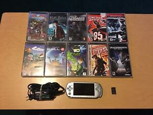 Silver Slim psp w charger, 1 Gb memory card and 10 games.