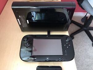 Rarely used Wii U w/consoles and games