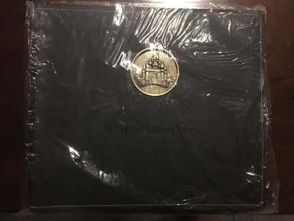 Brand new, sealed leather bound Disney world scrap book/photo album