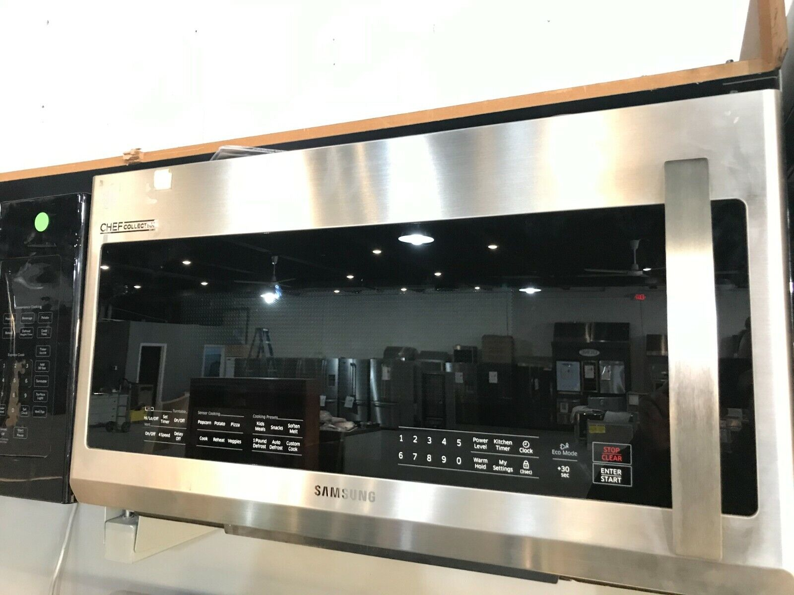 SAMSUNG 2.1 CU. FT. OVER-THE-RANGE CHEF COLLECTION MICROWAVE