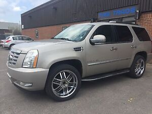 "2007 Cadillac Escalade with new 22"" inch tires on chrome rims"