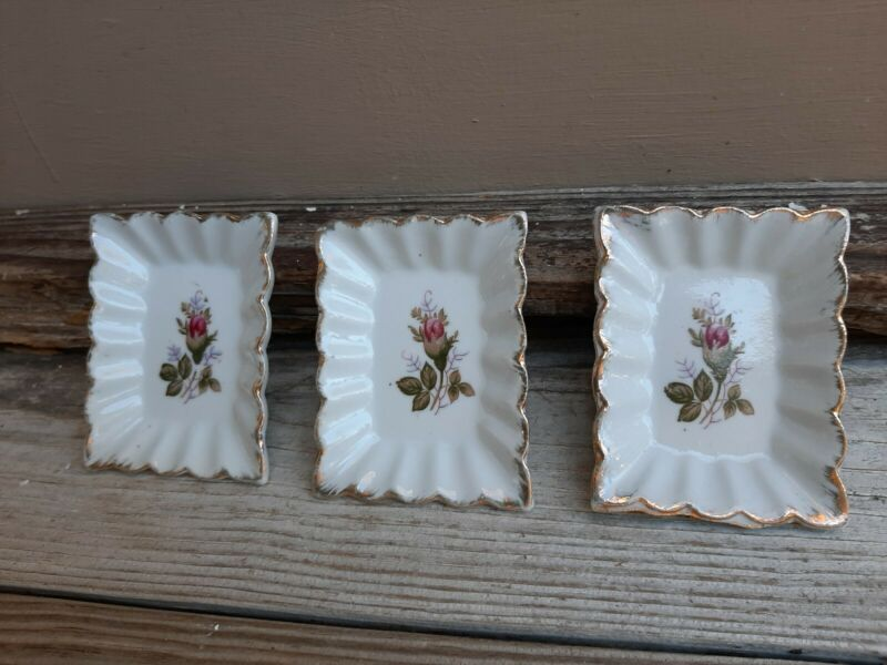 Vintage butter pat  porcelain dishes w/ rosebud design & gold accent edges Japan