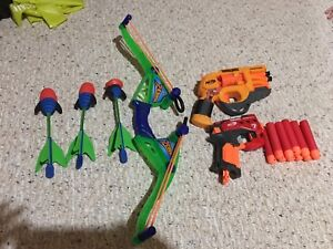 Nerf guns and bow and arrow