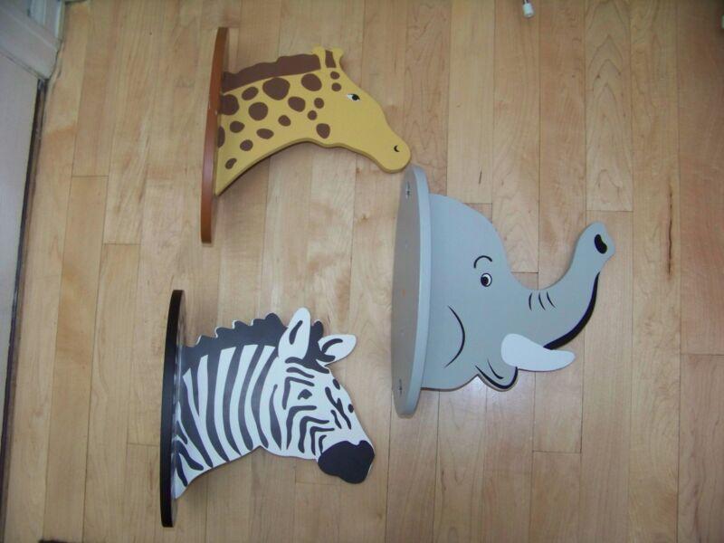 "Three animal clothes wall hangers elephant giraffe zebra 11"" tall 10"" deep 6"""