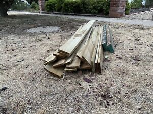 Free- treated timber fence palings