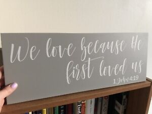 """""""We love because He first loved us"""" sign"""