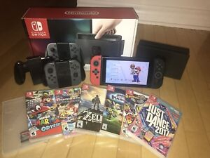 Nintendo Switch + 7 jeux ; 4 manettes / 7 games; 4 controllers.