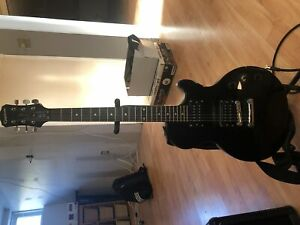 Les Paul Epiphone Special Model with a Marshall MG15CFX amp