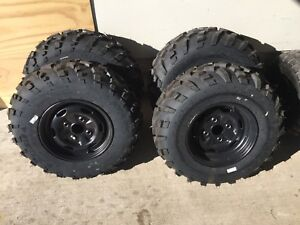Brand New Carlisle ATV Tires and Rims