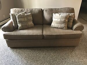 Beige couch and chair set