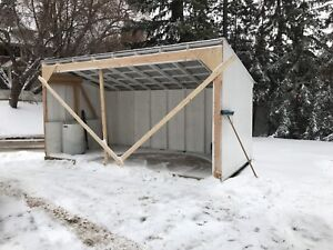 Two 8' x 16' sheds combine to workshop/shed/loafing sheds