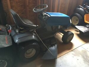 White riding lawn mower tractor