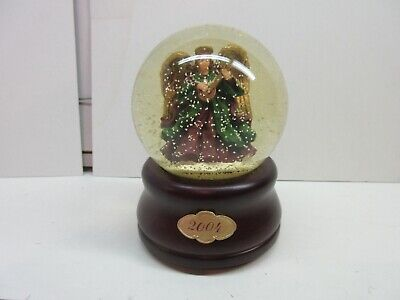 Angel snow globe with music box. Wooden base. 2004 -