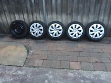 Toyota Corolla / Yaris wheel and tyres 15 inch plus HUP caps set Revesby Heights Bankstown Area Preview