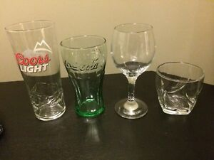 Coors Light Pint glass, Coca Cola glass, wine glass and tumbler.