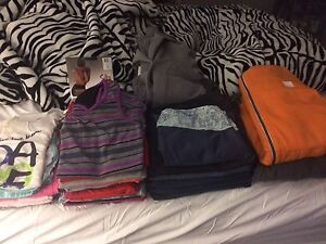 Lot of Women's Clothes. The sweaters are bench and Lululemon.