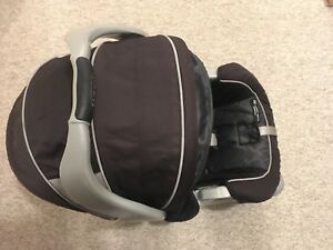 2 Graco Snugride Car seat/Baby carriers with Bases and Canopies