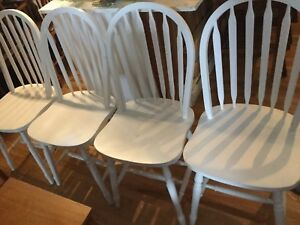 4 imperfect white chairs