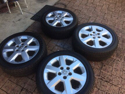 """HOLDEN / GM MAGS, 16""""  with  NEAR-NEW Tyres."""