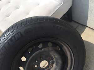P205/70r15 Michelin all season tires and rims from Toyota