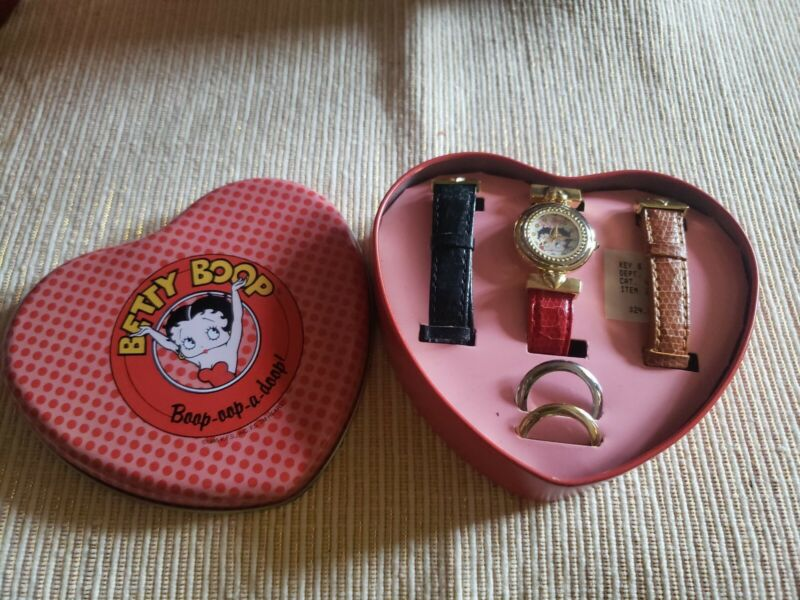Betty Boop Quartz Watch. 2 Extra Bands. 2 Extra Bezzals for watch. In Tin Box.