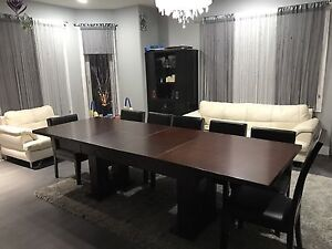 Sturdy table and 6 leather chairs