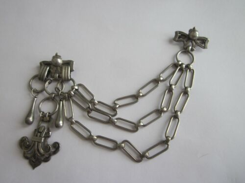 Rare  & Ornate  Stainless  Steel Sweater Guard