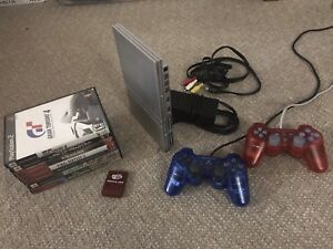Platinum PlayStation 2 console, controllers, and games