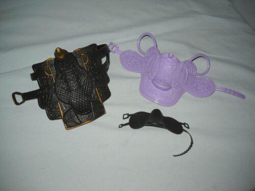 3 PLASTIC TOY HORSE SADDELS/ 2 KID KORE / 1 BARBIE  MATTEL