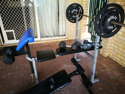 assorted weights and bench for sale