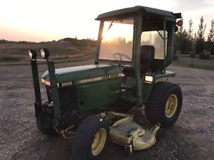 John Deere 855 Tractor with mower and blade