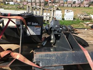 Bobcat auger with attachments