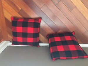 Two plaid pillows with feather inserts