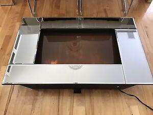 Foyer électrique avec miroir biseauté
