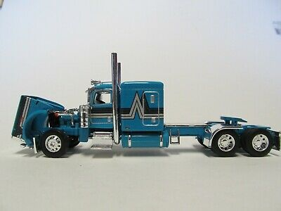 DCP FIRST GEAR 1/64 SCALE 389 PETERBILT FLAT TOP, TEAL WITH BLACK/ SILVER STRIPE 2