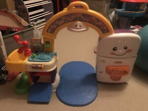 Fisher Price kitchen for crawling baby