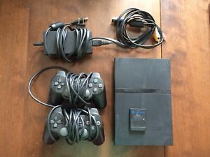 PlayStation 2 with 6 games.
